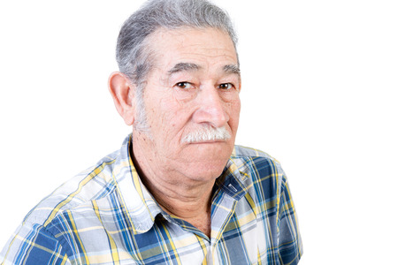 deadpan: One serious mature male with mustache wearing blue and yellow striped flannel shirt over white background
