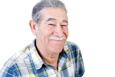 Authentic older Mexican man in casual flannel shirt with mustache grinning