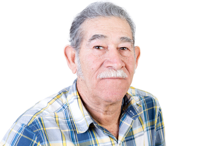 musing: Serious single middle aged Mexican man with mustache in middle class casual shirt over white background Stock Photo