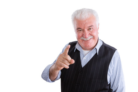 demonstrative: Pleased handsome male pensioner in vest with mustache on isolated background conversing and pointing finger