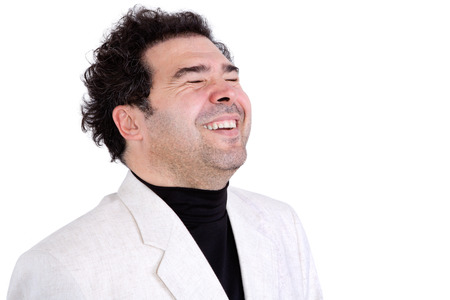 Isolated jovial middle-aged man with stubble and curly hair expressing spontaneous laughter