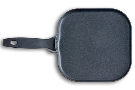 Overhead view of a clean lightly used square kitchen skillet with chamfered corners on a white background