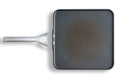 non: High Angle View of Well-Used Discolored Non Stick Square Pan with Handle, Still Life on White Background with Copy Space