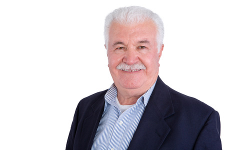 Single handsome smiling white haired and mustached man with unbuttoned collar and blue blazer over white background