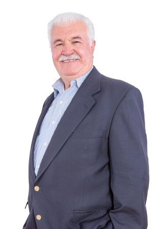 dignified: Dignified mature man in white hair and mustache standing over white background with hands in pockets of blue blazer Stock Photo