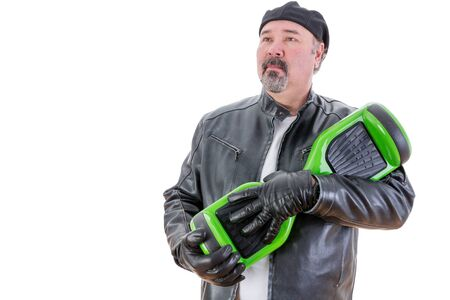a righteous person: Serious bearded middle aged overweight single man in leather coat and gloves holding his green and black hoverboardver white background