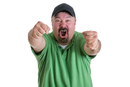venting: Waist Up of Excited Man Wearing Green Shirt and Baseball Cap Pumping Fists Toward Camera While Celebrating Team Win in Studio with White Background