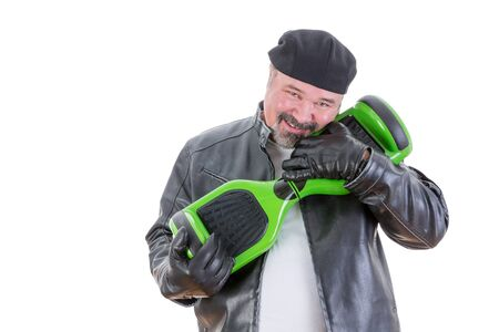 possessive: Smiling bearded middle aged overweight single man in leather jacket adoring his green and black hoverboard with hug over white background