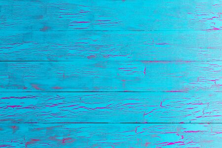 table surface: Colorful exotic crackle painted turquoise blue wood background texture in a close up full frame view of the cracked old boards Stock Photo