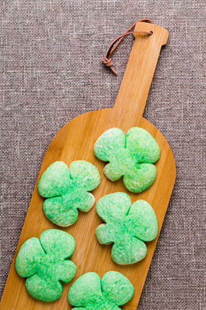 drown: Homemade green shamrock cookies for St Patricks Day on a bottle shaped wooden board symbolic of the traditional drink to - Drown The Shamrock