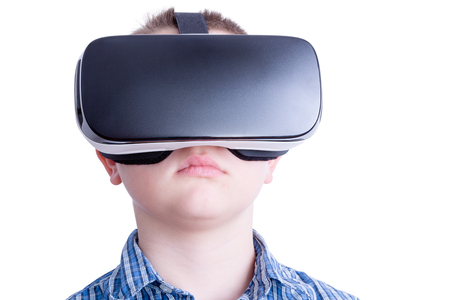 unemotional: Close up on hypnotized male child watching something on virtual reality headset over white background