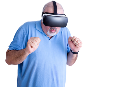 balding: Man reactingSingle middle aged bearded and balding man in blue shirt reacting to action in virtual headset over white background to action in virtual headset