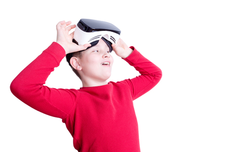 sleeve: Smiling boy in red long sleeve shirt lifting his virtual reality headset over eyes to see something in front of him