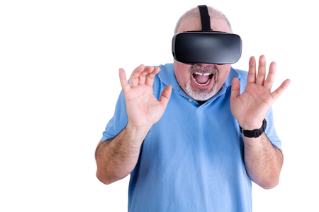 demonstrative: Happy man in blue polo shirt and virtual reality glasses screams while holding his hands up