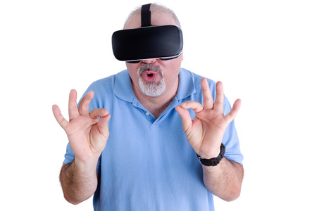 stimulate: Man on white background wearing virtual reality glasses rounds his lips and gestures with his hands Stock Photo
