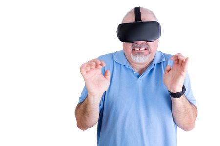 repugnant: Squeamish man in blue against a white background wearing virtual reality glasses and a black wrist watch Stock Photo