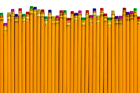 eliminating: Top down view on row of yellow pencils with colorful eraser tops at different heights as concept for eliminating various mistakes