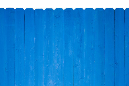 royal blue: Simple wooden slat fence with parallel planks stained with royal blue paint over a white beackground