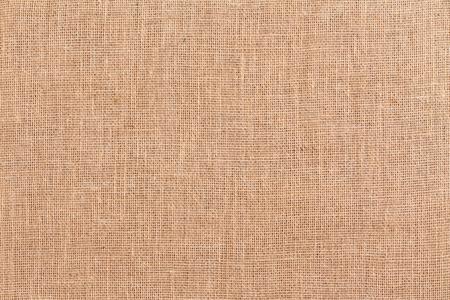 Textura completa do fundo de serapilheira ou hessian tecido marrom do quadro feito das fibras naturais tecidas vistas perto acima das despesas gerais Foto de archivo