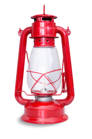 fuel chamber: Isolated image of red kerosene lantern with glass chamber and metal frame against a white background
