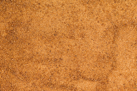crystallized: Background texture of organic coconut sugar made from the crystallized sap of cut flower buds on the coconut palm and used as a sweetener for its low glycemic index Stock Photo