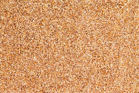 durum: Background texture of fine ground brown bulgur made from cracked durum wheat or cereal groats rich in protein and dietary fiber for a healthy whole grain ingredient