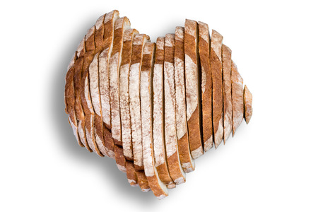 high quality: High quality sliced bread in shape of heart over white background for Valentines Day or love concept