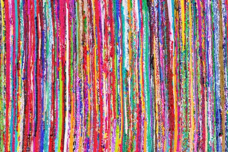 multicolored: Close up colorful hand woven rug with red, blue, yellow, purple and other colors as background