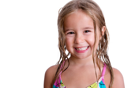 blond girl: Close up on single cheerful little girl with big cute smile and long blond wet hair over white background