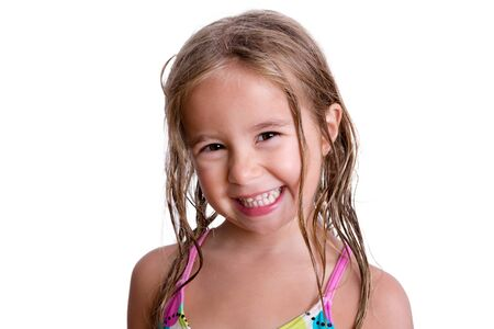 facial expression: Single happy smiling young female child with long blond wet hair over white background