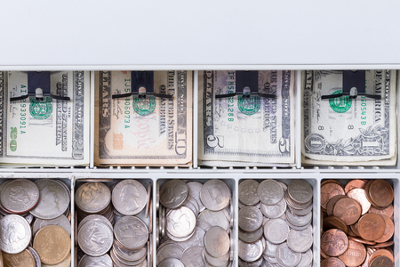 Close up on American currency in cash drawer consisting of pennies, dimes, nickels, quarters and various paper bills Reklamní fotografie