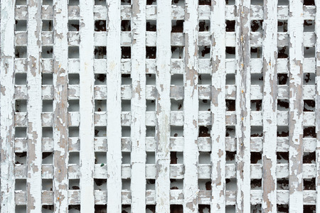 trellis: Worn out wooden lattice fence background with copy space for pattern concept about neglect or something obsolete Stock Photo