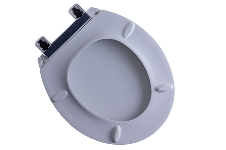 loose fitting: Close loose toilet seat and lid isolated on white with a view of the underneath of the plumbing fitting, orientated diagonally with copy space Stock Photo