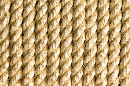 strands: Close up on vertical strands of thick yellow rope as background with copy space for texture themes