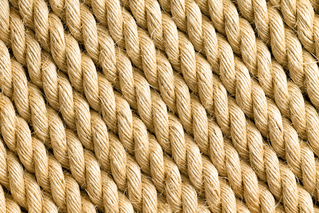 strands: Diagonal strands of thick yellow rope as background with copy space for texture themes