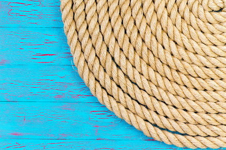 cordage: Circular shape made of thick rope in corner of blue ocean themed wooden background Stock Photo