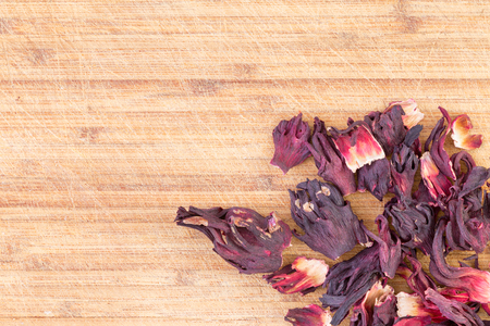 lowers: Dried hibiscus sepals from the crimson Hibiscus sabdariffa plant for making an infusion or herbal tea with strong antioxidant properties, lowers blood pressure, immune system and anti-inflammatory