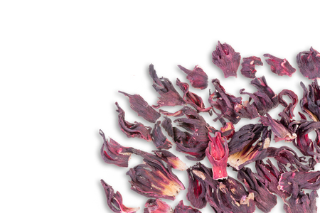 Dried hibiscus tea leaves scattered on white background as seen from an overhead view 免版税图像