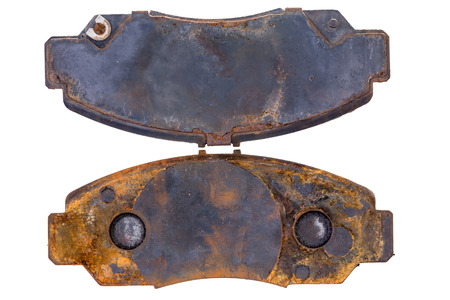 Pair of old rusty worn brake pads or callipers viewed from above on a white background in a concept of maintenance and repair Stok Fotoğraf