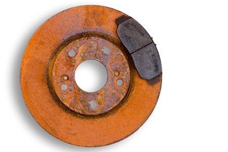 Single heavily corroded rusty red brake rotor and worn pad or calliper isolated on white with copy space Stock Photo