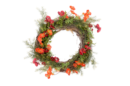grass flower: Autumn wreath with fresh green foliage and colorful orange flowers arranged on an intertwined twig base isolated over white