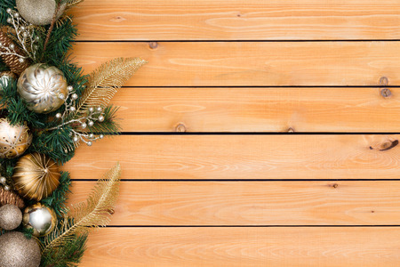 Festive background featuring christmas garland with foliage and ornaments