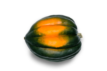 Close Up Side View Still Life of Single Whole Acorn Squash with Green and Orange Skin in Silhouette on White Studio Background with Copy Space