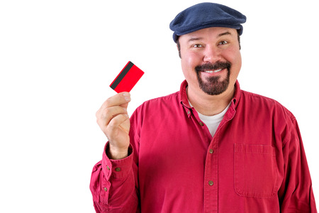 viability: Motivated man with a bright idea holding a credit card up in his hand with a big smile as he imagines the opportunities that it opens up for him if he utilises the funds