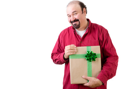 upper body: Grateful man holding a large gift with fancy green bow which he has just received in his hands with a happy smile of pleasure and thanks, upper body isolated on white with copy space