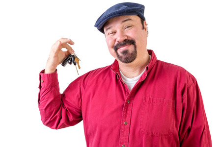 fulfilling: Proud privileged man holding a bunch of car keys after purchasing a new vehicle and fulfilling his dreams, isolated on white