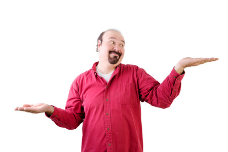 Middle aged man with goatee weighing up pros and cons with hands on white Stock Photo