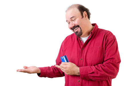 upturned: Smiling middle aged man with empty upturned hand and credit card on white Stock Photo