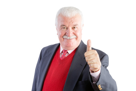Cheeky senior gives a thumbs up and smiles at the camera while wearing a business suit