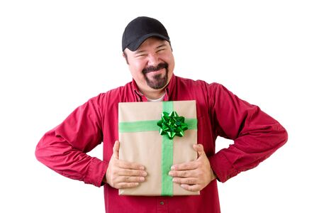 Half body portrait of excited man in baseball cap with wrapped present, white background